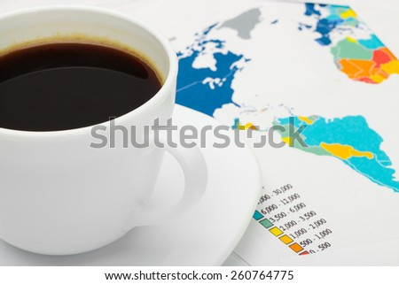 Coffee cup over world map - business concept - stock photo