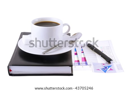 Coffee cup, pen,standing on the personal organizer-  with   financial  diagrams  under organizer. Isolated - stock photo