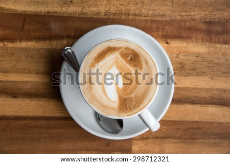 Coffee cup top view on old wooden  - stock photo