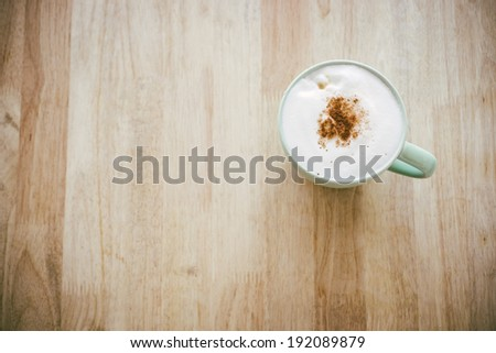 Coffee cup top view on wooden background - stock photo