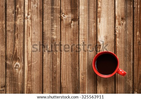 Coffee cup top view on wooden table - stock photo