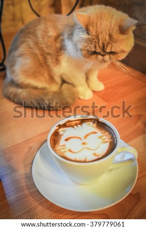 Coffee cup with artistic cream cat face decoration, cat backgroud - stock photo