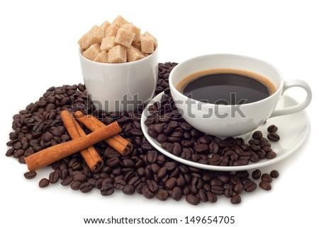 Coffee cup with beans and sugar on white background