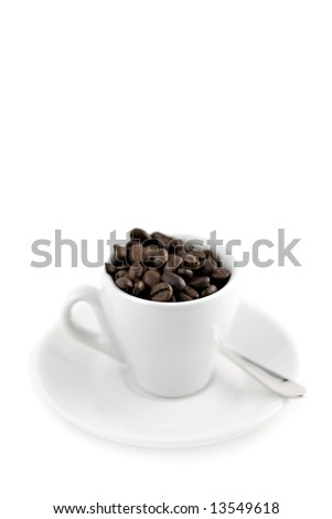 coffee cup with beans isolated on white, Shallow depth of field - stock photo