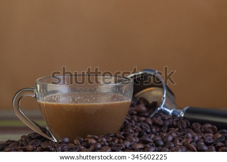 Coffee cup with beans on grunge brown background - stock photo