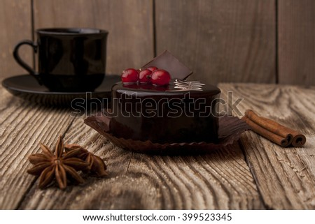 Coffee cup with chocolate cake on wooden background     - stock photo