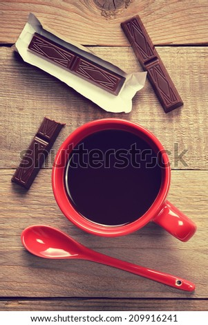 Coffee cup with chocolate in retro style - stock photo