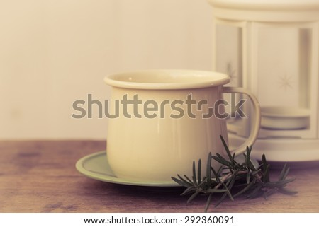 Coffee cup with Christmas lantern abstract background on white boards - stock photo