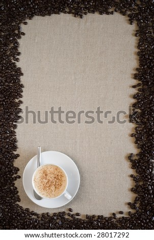 Coffee cup with coffee beans around with space for copy. - stock photo