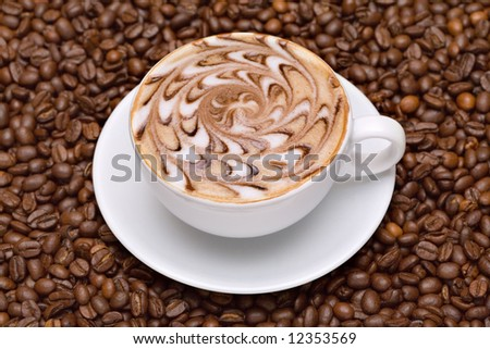Coffee cup with coffee beans background - stock photo