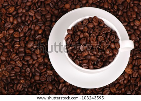 coffee cup with coffee beans copyspace