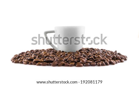 Coffee cup with coffee beans on white background - stock photo