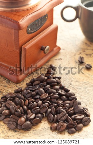 Coffee cup with coffee grinder - stock photo