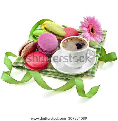 coffee cup with colorful macaroons in a table serviette isolated on a white background - stock photo