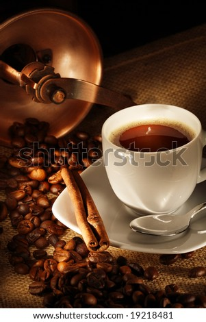 coffee cup with grinder, fresh beans and cookies - stock photo