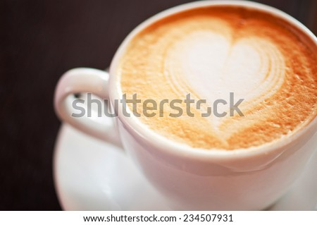 Coffee cup with heart shape - stock photo