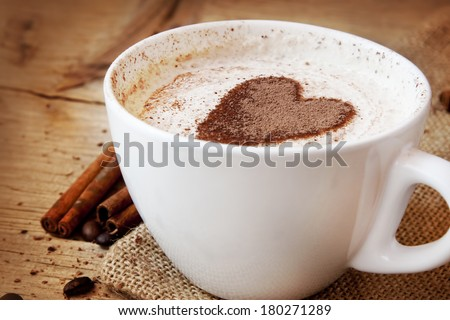 Coffee Cup with Heart Shape Made From Cocoa in the Cream - stock photo
