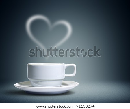 Coffee cup with heart shaped white smoke - stock photo