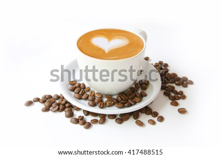 Coffee cup with latte art heart shape and beans isolated on a white background.  - stock photo