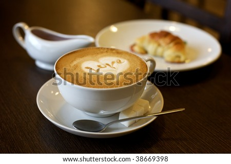 Coffee cup with milk and heart shape (selective DOF) - stock photo