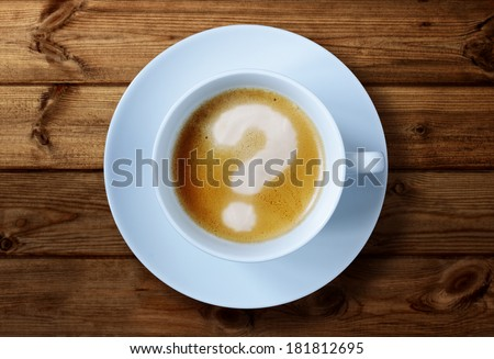 Coffee cup with question mark in the froth concept for problems, uncertainty and asking questions - stock photo