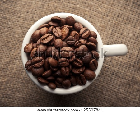 coffee cup with roasted beans. top view. - stock photo