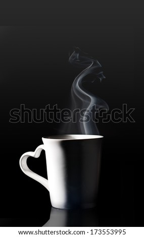 coffee cup with smoke isolated black background - stock photo