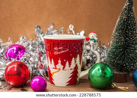 coffee cup  with snow man, Christmas ball and tree, decorate on wooden background for Christmas holiday ,vintage color tone. - stock photo