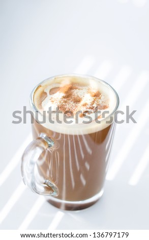 Coffee cup with spoon on the table