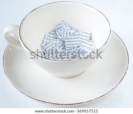 Coffee cup with torn DNA sequence in it, half full - stock photo
