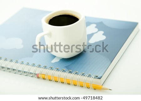 coffee cup, yellow pencil and spiral notebook - stock photo