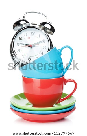 Coffee cups and alarm clock. Isolated on white background - stock photo