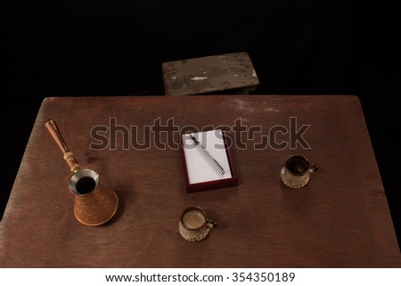 Coffee cups and note paper on the table.Top view. Dark background.