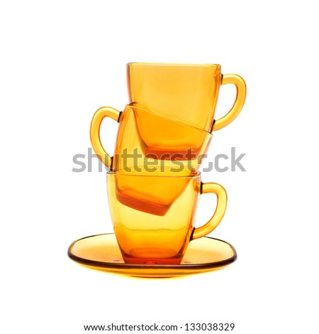 Coffee cups. Empty yellow glass dish over white background.