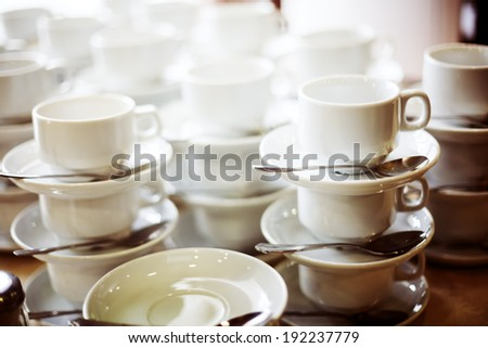 Coffee cups in a bar. Selective focus, shallow depth of field - stock photo
