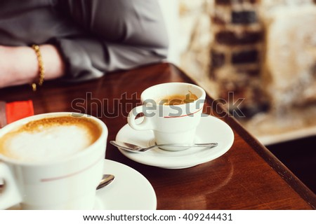 Coffee cups in a Parisian indoors Cafe - stock photo