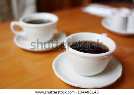 Coffee cups on a table.