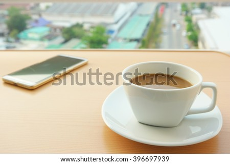 Coffee cups white, and smart phone