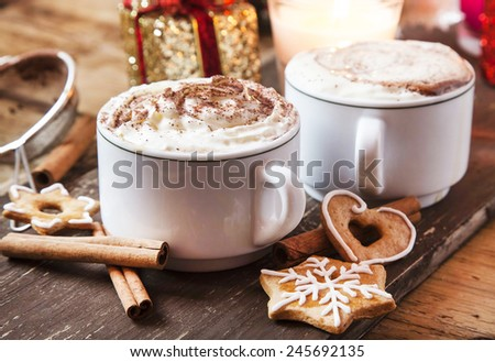 Coffee Cups with Whipped Cream, Cocoa Powder and Cinnamon with Gingerbread - stock photo
