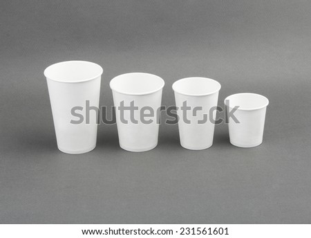 Coffee drinking cup sizes. Paper coffee cup on a grey background - stock photo