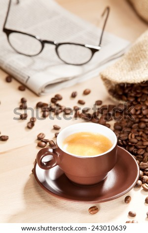 Coffee enjoyment with classic reading material - stock photo