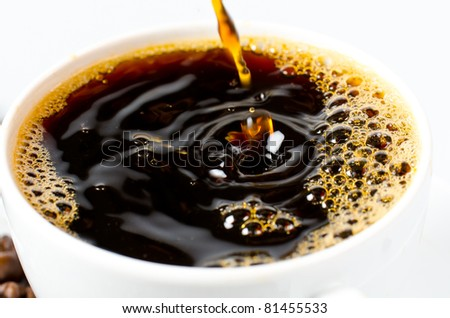 Coffee espresso being poured into a blurry movement - stock photo