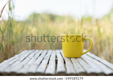 Coffee espresso on bamboo table nature background in garden.