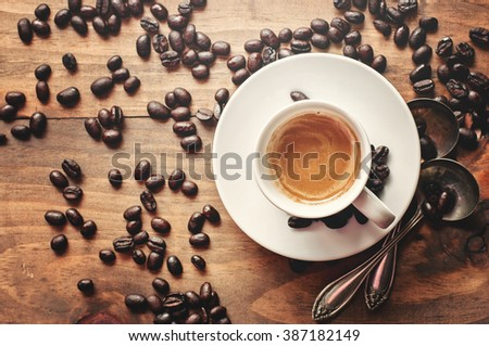 Coffee, espresso on rustic background, toned image, selective focus