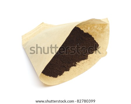 Coffee filter with powder isolated on white background - stock photo