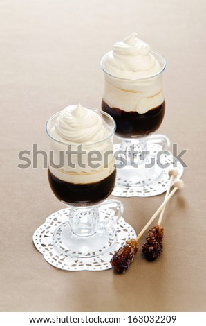 coffee - frappe in glass cups on napkins with sugar sticks - stock photo