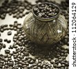 Coffee from the South America. Coffee grains in the jug made by Indians and ornamented manually. focus selective - stock photo