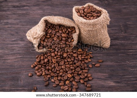 Coffee grains in bags against a dark background