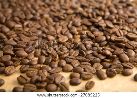 coffee grains on a yellow paper close-up