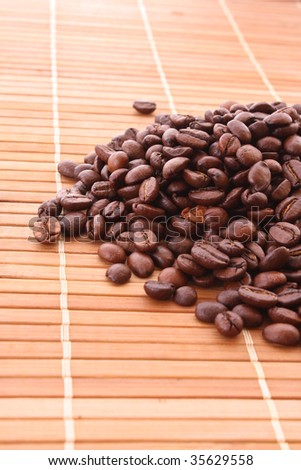 Coffee grains on brown background